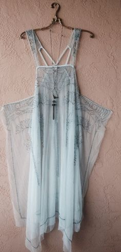 The glamour of the 1920s comes alive with Free People's embellished Art Deco dress--a sheer, slip-like overlay that lends an enchanting touch over your favorite base layer.