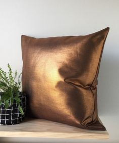 Our Striking Copper Denim Cushion Cover! SIZE: 16x16 inches 18x18 inches 20x20 inches  FABRIC: Foil Coated Denim 50% Polyester, 47% Cotton, 3% Spandex  COLOUR: Copper  CARE: Cold Wash and Hang Dry  FEATURES: Seams have been overlocked for durability and a professional finish. Invisible Zipper closure for a tailored look. PLEASE NOTE: ---This listing is for One Cushion Cover. Cushion Inserts are not included. Inserts can be purchased from your local haberdashery store. --- Products displayed…