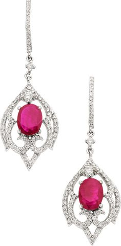 Ruby, Diamond, White Gold Earrings, Piranesi  The earrings feature oval-shaped rubies weighing a total of 3.19 carats, enhanced by full-cut diamonds weighing a total of 1.06 carats, set in 18k white gold, completed by posts with lever backs, marked Piranesi.