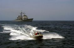 At sea with USS Thomas S. Gates (CG 51) May 7, 2003 -- Maritime Interdiction Operations personnel assigned to the guided missile cruiser USS Thomas S. Gates approach the yard patrol craft YP-702 in a rigid hull inflatable boat (RHIB) to conduct Maritime Interdiction Operation (MIO) and Vessel Board Search and Seizure (VBSS) team training. U.S. Navy photo by Gary Nichols. (RELEASED)