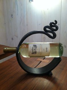 Forged wine holder