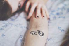 simple matryoshka tattoo; would get this in memory of my grandma <3