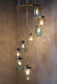 Basic beauty shines bright with our spiraling Mason jar chandelier! This staggered waterfall chandelier is ideal for stairwells or entryways and is perfect over an island or a table. The chandelier can either be wired directly into the ceiling or it can hang from hooks and plug into any wall outlet.