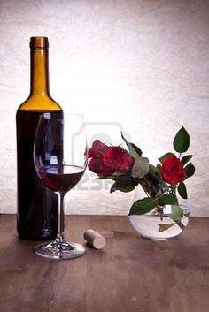 """""""Los mejores vinos son los que nosotros tomamos con los amigos"""" Red wine and roses .... :)"""