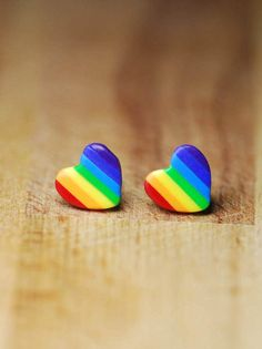 Heart shaped polymer clay (Fimo) stud earrings on hypoallergenic plastic posts. As there are multiples each pair will be slightly different but the same colours and shape. Our other sexuality flag earrings can be found here -