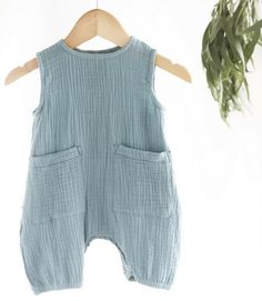 Koala Bub's organic cotton muslin unisex sleeveless baby jumpsuit in ocean blue from Elves in the Wardrobe, an Australian based Eco clothing store offering the best organic baby & kids clothes, ranging from newborn up to size 12, as well as a carefully selected range of safe Eco toys and accessories for your little one