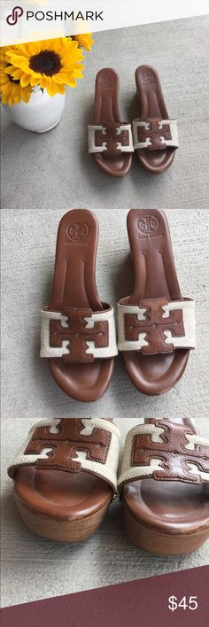 Tory Burch Wedge Platform Slide Sandals Size 8 Tory Burch wedge platform slide sandals size 8. Brown and tan and perfect for any summer outfit. Worn several times with a little bit of wear on the bottom and near the toe. Not noticeable when you wear them. Tory Burch Shoes