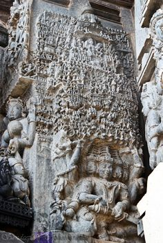 Ravana shaking mount Kailash: Ten-headed demon king Ravana is holding up Kailas mountain. You can see Lord Shiva is sitting with his beloved Parvathi on the top of the mountain. BELUR.