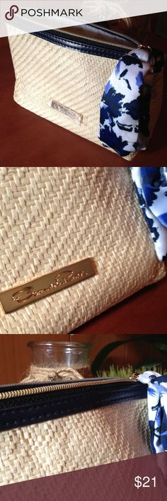 Oscar de la Renta bag Darling straw raphia bag by Oscar de la Renta with blue floral zip pull and blue band at the top.  Trending Blues in Natural fabric are great for SPRING/SUMMER 2017. Makeup travel bag or may be used as a clutch. Polyester lining and straw paper raphia. Oscar de la Renta Bags Clutches & Wristlets