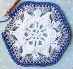 The Captured Snowflake Granny Square pattern is a fun 3- in -1 crochet pattern. It's a snowflake, a hexagon and a granny square. Get your free copy at #crochetalot . #grannysquare #christmascrochet #crochet #freepattern