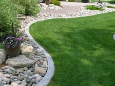 Landscaping with rocks outdoor-living - pavers outlining the rocks.