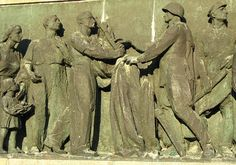 Socialist realism - A relief from the Soviet military cemetery in Warsaw showing workers greeting victorious soldiers
