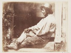 Man seated in doorway, 1845. Salted paper print from calotype negative.