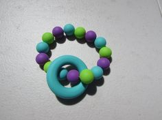 Silicone Teething Ring A beautiful colourful teether that your baby will love! The ring and beads are made from food grade Teething Necklace, Necklace Ideas, Food Grade, New Moms, Beads, Trending Outfits, Unique Jewelry, Handmade Gifts, Rings