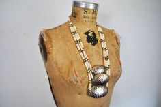 Hammered Metal and Bone Beaded Necklace by badbabyvintage on Etsy