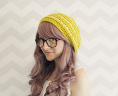 Sweet & Chic Mustard colored slouchy beanie from HELLOhappy. This hat is so cute! We love the little crotchet pom pom on the back. #scottsmarketplace