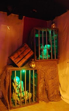 Halloween haunt inspiration for CarnEvil scene (make better cages & lighting)