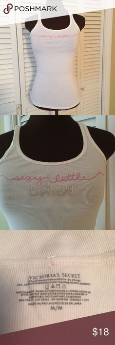 """""""Sexy Little Bride"""" Tee Excellent condition.  Absolutely no stains,  tears,  or snags.  Not sure it was ever worn. White with pink writing along with Silver embellishment. Victoria's Secret Tops Tank Tops"""