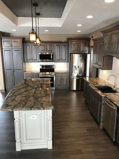 I love how my kitchen counters turned out! Cambria Langdon. Cambria Quartz. Koch Cabinets. Kitchen Island is Birch wood with Oyster stain.
