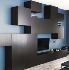 Black-brown BESTÅ VARA media storage takes organization to another level with Tetris-style wall units