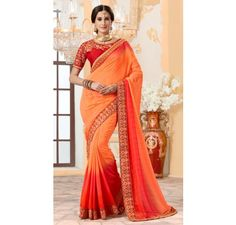 Red silk saree with embroidered blouse