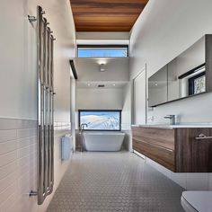 """curtis designed this modern ski chalet located in Lac Archambault, Quebec, Canada. It was completed in February """"This modern ski chalet was designed as a weeke… Chalet Design, House Design, Bathroom Wall Decor, Bathroom Furniture, Small Bathroom, Master Bathroom, White Bathroom, Washroom, Bathroom Ideas"""