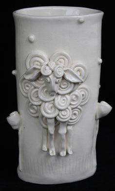 Cute clay vases by clayfarm.