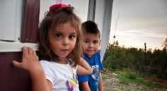 Jimena Maldonado, and her brother, Christian, stand in front of their new trailer. (Photo: Laura Reinhardt/World Vision)