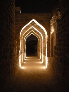 The Bahrain Fort entry way at night.
