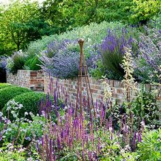 Invest in an Iron Obelisk - in Country Garden Design Ideas - how to a create a well-planned herbaceous border and farmhouse or cottage look, ideas for gardens both big and small.