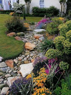 Front Yard Landscaping How to Install a Dry Creek Bed-Control the flow of rainwater across your landscape with an easy-to-install dry creek bed. - Control the flow of rainwater across your landscape with an easy-to-install dry creek bed. Landscaping With Rocks, Front Yard Landscaping, Dry Riverbed Landscaping, River Rock Landscaping, Hillside Landscaping, Farmhouse Landscaping, River Rock Patio, Wooded Backyard Landscape, Privacy Landscaping