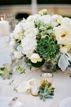 Ivory-Rose-and-Succulent-Centerpiece  http://www.elizabethannedesigns.com/blog/2012/01/02/elegant-yellow-gray-wedding/
