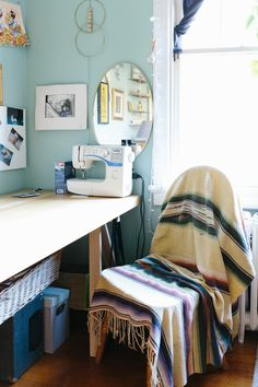 The couple's desks from Ikea are simple staples surrounded by inspiration, memories, and thrift store finds.