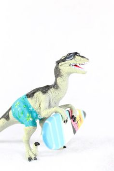 Surfing Raptor dinosaur. Cake topper,  painted birthday and room decor by PaintedParade