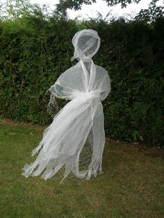 Halloween chicken wire ghost dressed in cheesecloth. View 1
