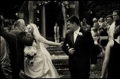 Dad kissing bride.