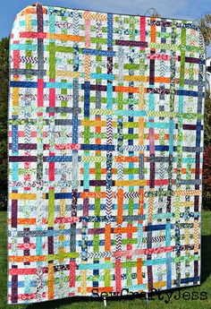 "Simply Woven quilt tutorial by sewcraftyjess at Moda Bake Shop. Considered ""Moderate"" difficulty. Uses 2 jelly rolls and a solid for the front."