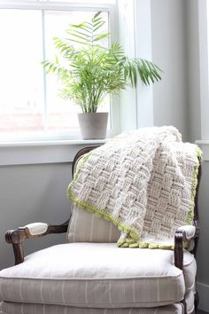 """Squishy yarn heaven! This free crochet basket weave blanket pattern is blooming with texture and makes a perfect lapghan-sized afghan. Made with Lion Brand Wool-Ease Thick & Quick in """"Fisherman"""" and Hometown USA in """"Monteray Bay."""" 