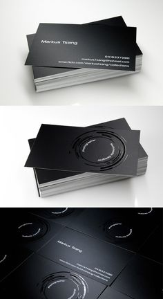 Photography-theme business card with a black background and high gloss rings that depicts a camera's lens.