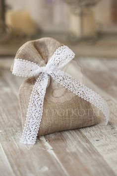 Shabby chic linen burlap pouch wedding favor tied with an elegant lace ribbon, filled with 5 sugared almonds koufeta.