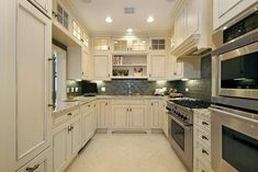 """Traditional Kitchen with flush light, High ceiling, Stone Tile, Kenmore 49613 30"""" Electric Combination Wall Oven, Slate Tile"""