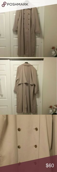 Plus Size 24W Trench Coat Please be advised that there are two listings because one has a stain and one doesn't.  Ensure that you are purchasing the correct item. Plus size 24W long and heavy trench coat Double breasted, no hood, no ties, split in back and fully lined This one has discoloration at the very bottom on the coat- see pictures  There is also one tiny white stain on the inside lining on the right side 100% Polyester  Dry clean only No rips or tears  Pet-free, pest-free…