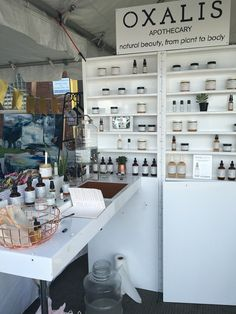 Oxalis Apothecary display at Renegade Craft Fair June 2016 - love the shiny white texture and there's a sink to try out products.