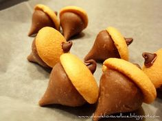 """Acorns"" - so simple yet so cute! Kisses with mini-Vanilla Wafers. These look adorable as Fall cupcake toppers. http://www.nashvillewraps.com/candy-boxes/bakery-cupcake-boxes/c-048904.html"