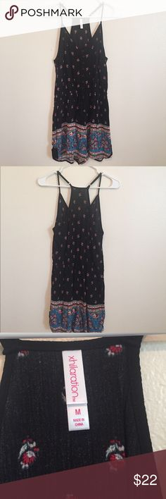 NWOT Floral black and red romper A floral black and red romper in a size medium. Has buttons in the front and elastic in the middle. Brand new and has never been worn! Xhilaration Dresses