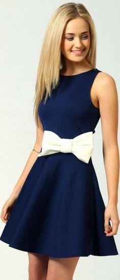 Navy blue frock with a white bow and the middle.....don't like the bow...take it off and use a really cute belt around the waist