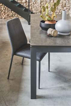 """Lightweight and practical chair, the """"Club"""" chair stands out for its versatility. The colour of the coated tapered leg always matches the seat. The uniform finishes make this chair perfect for both your dining and living area. Available in pre-treated stain resistant fabric or Gummy. #calligaristoronto #modern #italian #dining"""