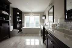 This is the perfect sized master bathroom and I love the sterile look with dark cabinets.