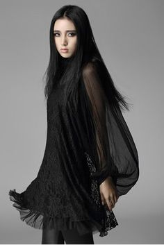 This beautiful black gothic dressby Punk Rave is made from black chiffon and lace and has large bishop sleeves.The hemline and neckline are frayed.