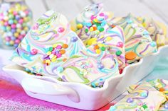 Unicorn Bark is an easy and pretty white chocolate bark, decorated with pastel swirls and colored sprinkles. Bring a little pixie magic to your candy!